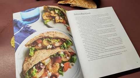 Cookbook open to pita recipe